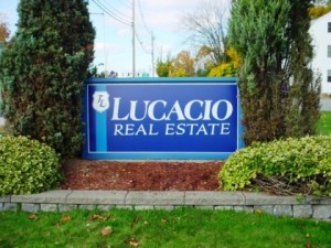 An image showing a real estate business sign